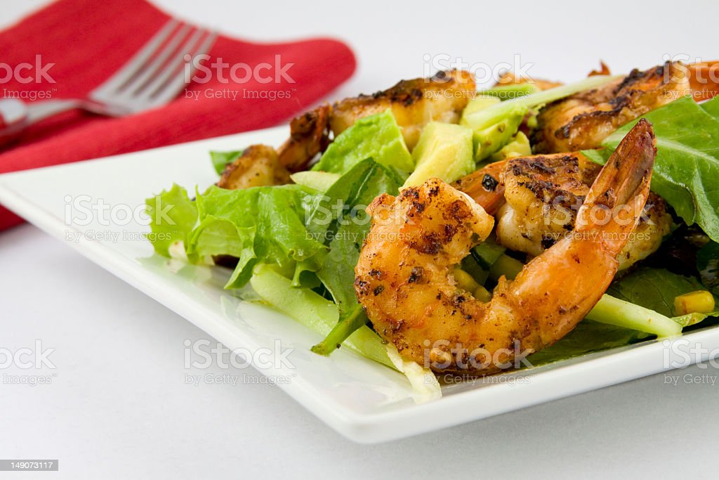 Close-up of grilled shrimp salad with avocado royalty-free stock photo