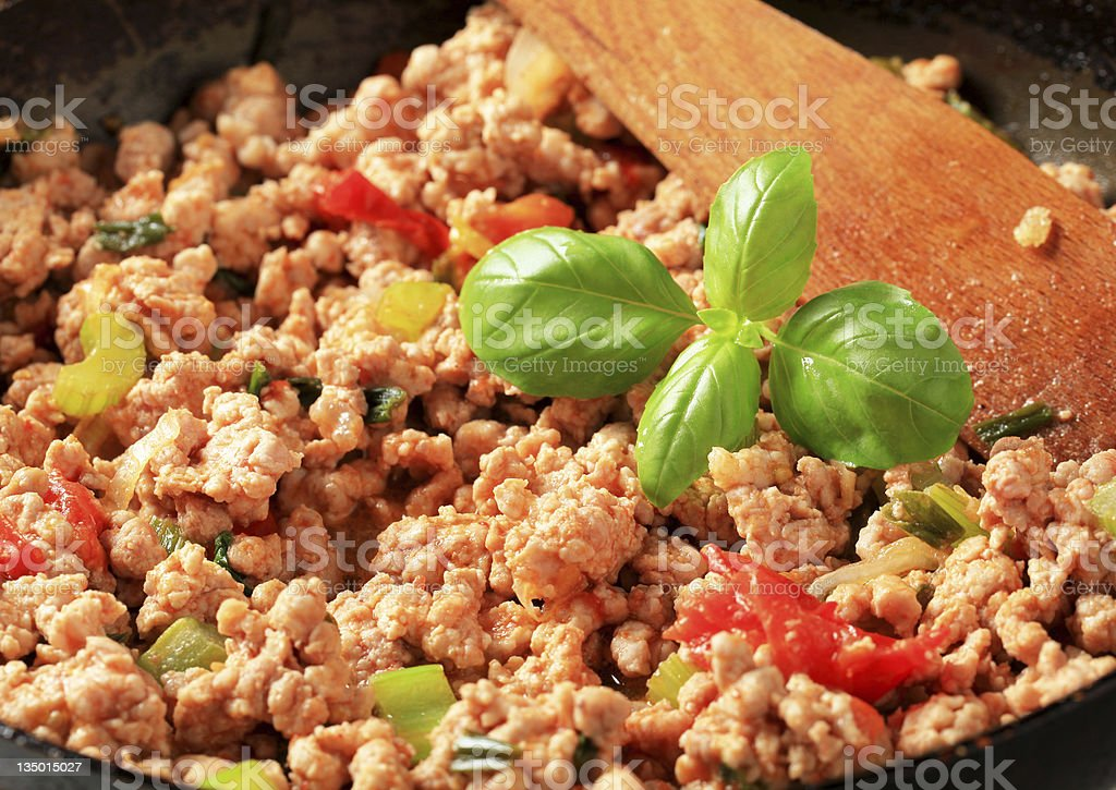 Close-up of ground meat stir fry cooking stock photo