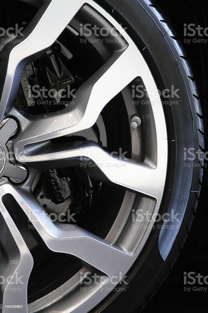 Close-up of half of a sporty tire stock photo