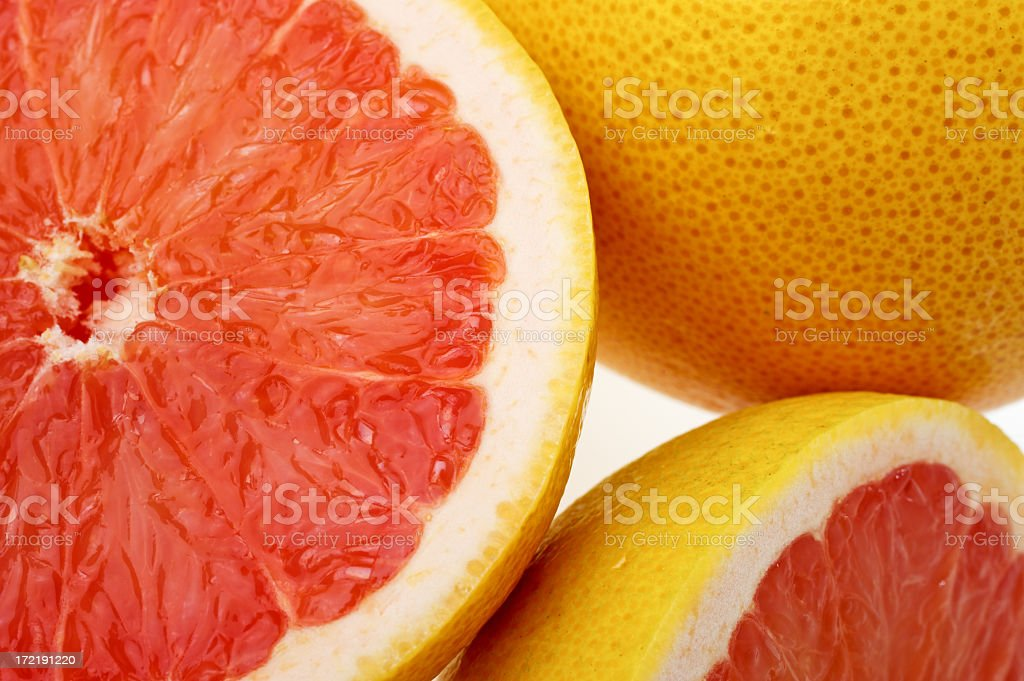 Close-up of halved grapefruits stock photo