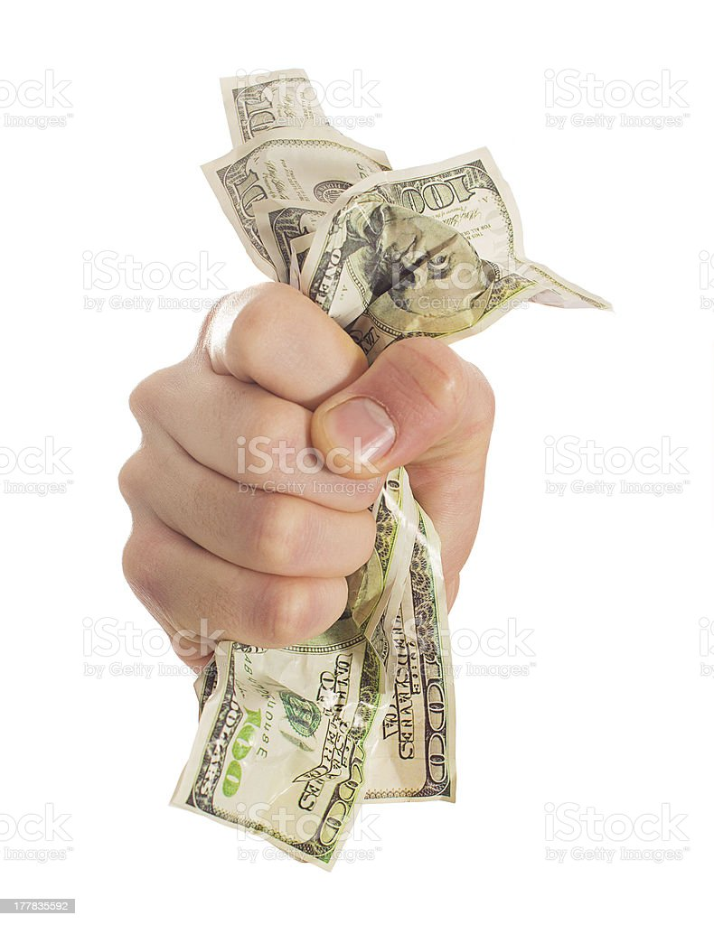 Close-up Of Hand Crushing Bank Note stock photo