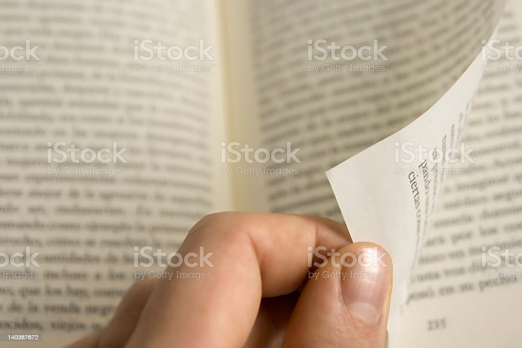 Close-up of hand flipping book page stock photo