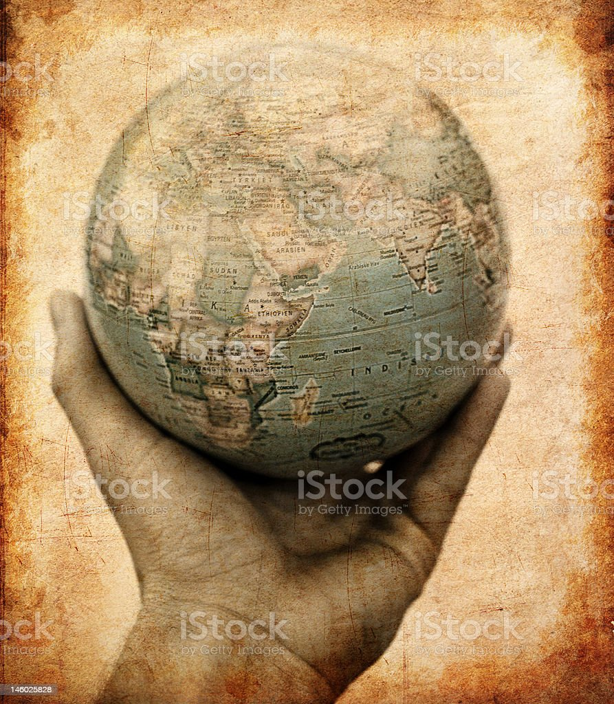 Close-up of hand holding a globe royalty-free stock photo