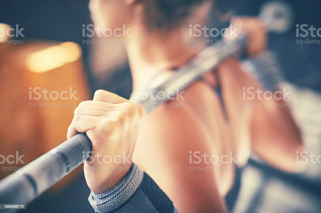 Close-up of hand holding barbell rod in gym stock photo