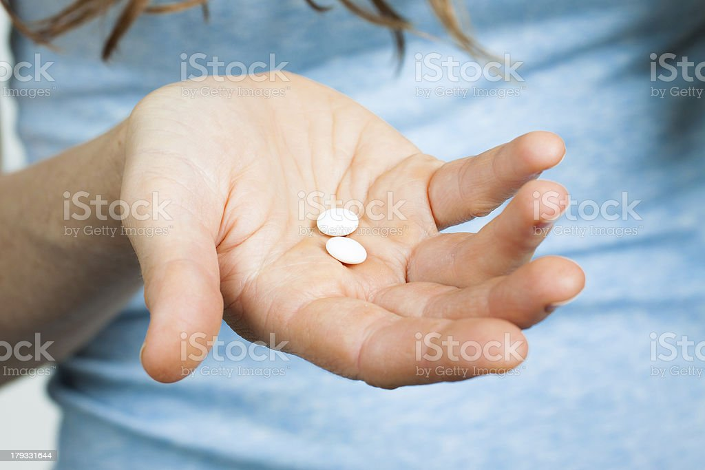 Close-up of hand holding pills stock photo