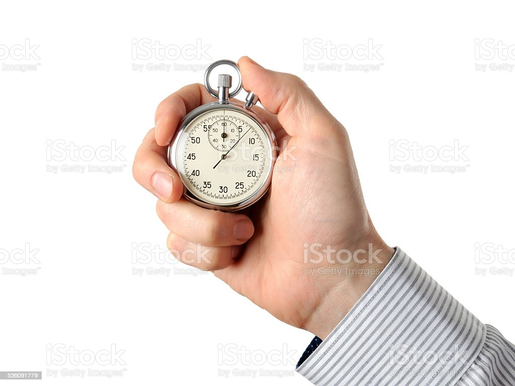 Closeup of hand holding stopwatch, isolated on white background stock photo