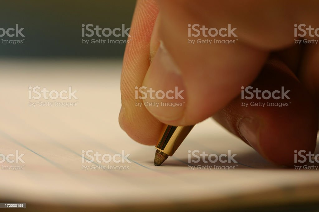 Close-up of hand in the process of writing notes stock photo