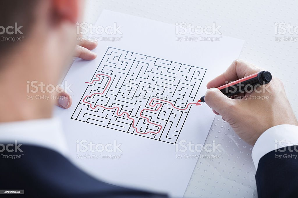 Close-up Of Hand Solving Puzzle stock photo