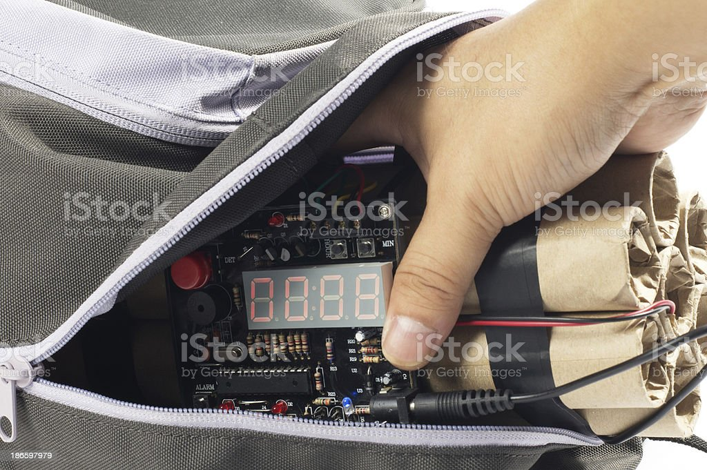 Close-up of Hand Taking Time Bomb royalty-free stock photo