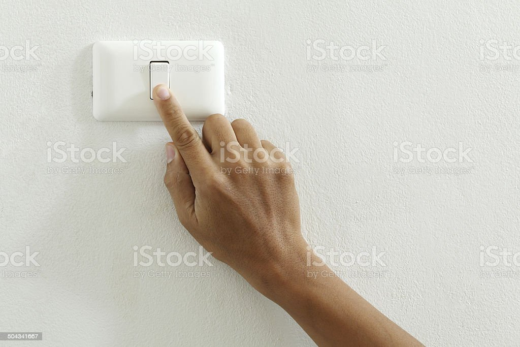 closeup of hand touch electric switch stock photo