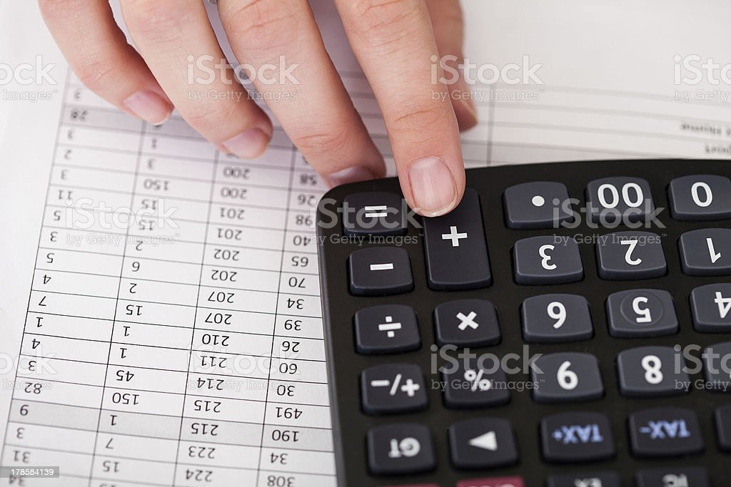 Close-up Of Hand With Calculator royalty-free stock photo