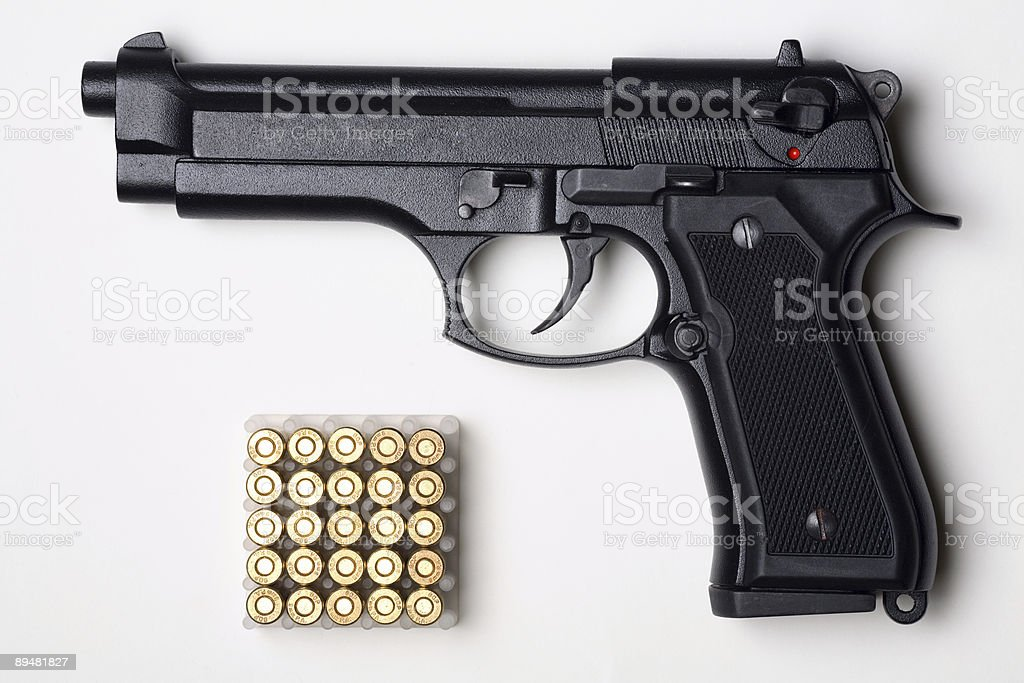 Close-up of handgun with a set of bullets royalty-free stock photo