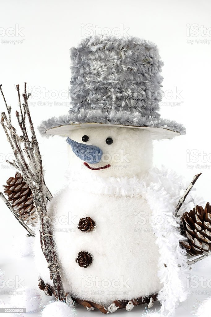 Closeup of Handmade Snowman surrounded by Snowballs stock photo