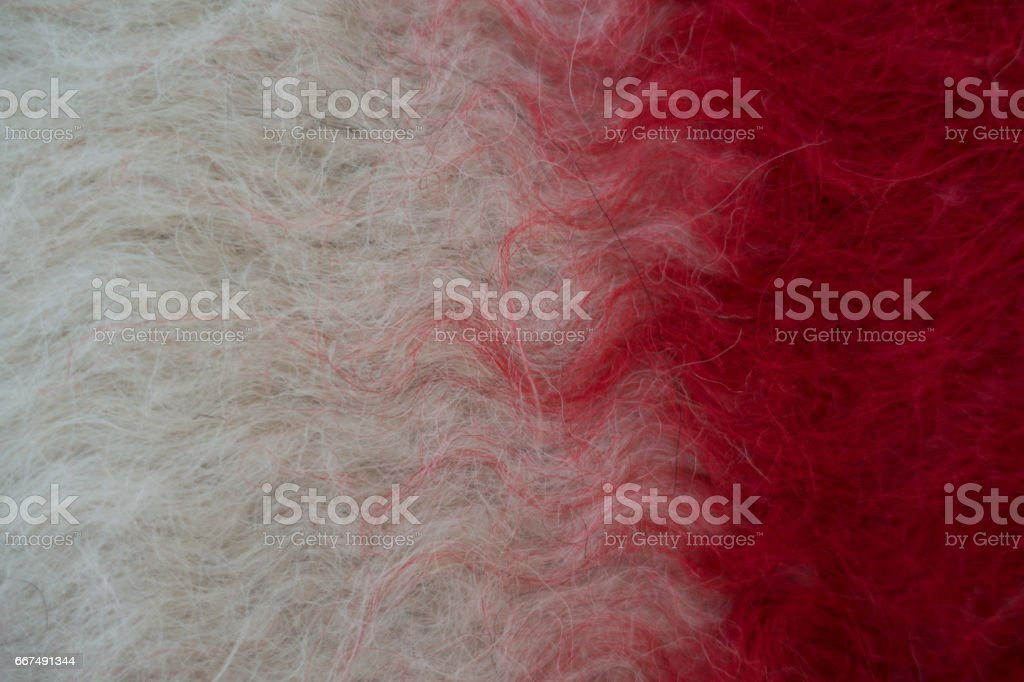 Close-up of handmade woollen felt blanket in white and red stock photo