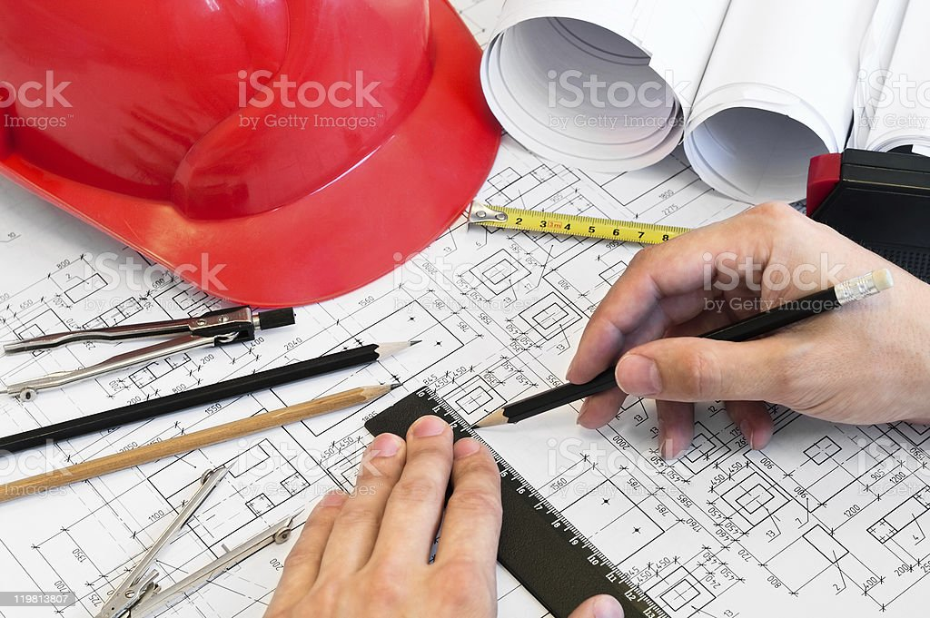 Closeup of hands drawing floor plans royalty-free stock photo
