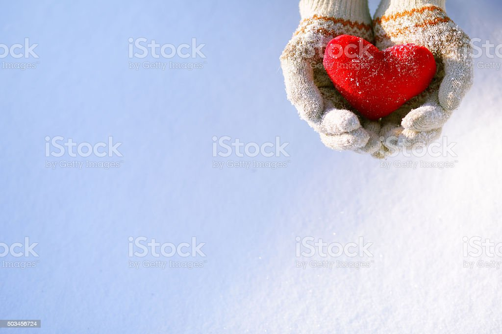 Close-up of hands holding a red heart shape stock photo