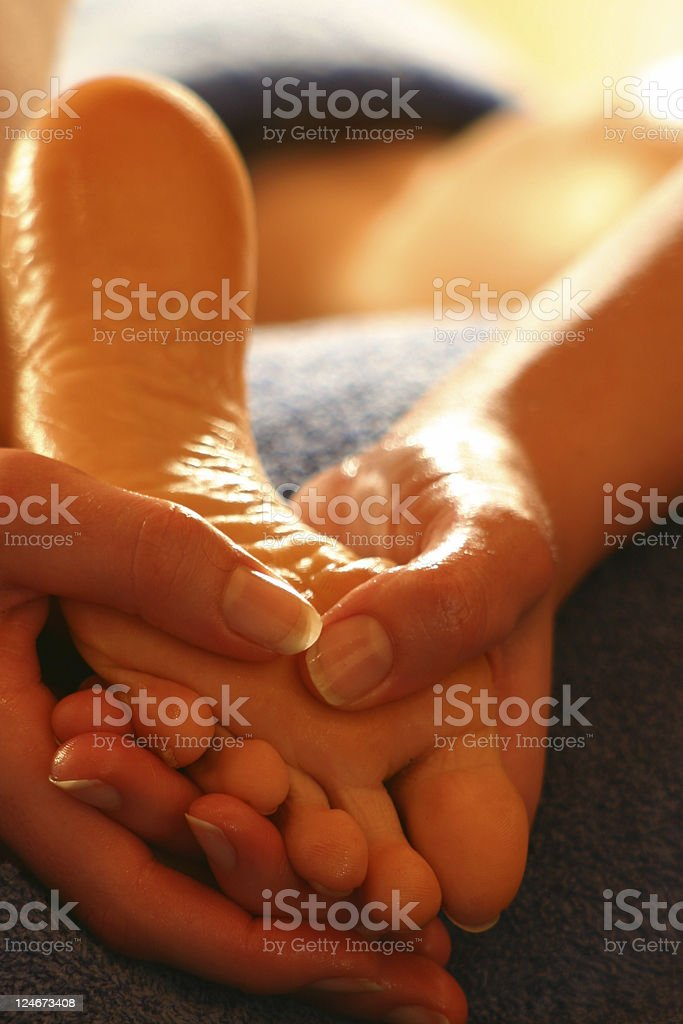 Close-up of hands massaging a foot royalty-free stock photo