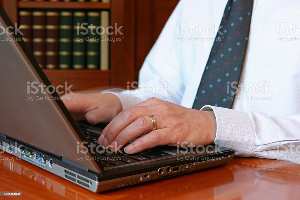 Close-up of Hands of a Businessman Typing on Computer Keyboard royalty-free stock photo