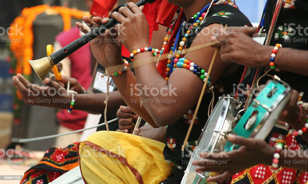 Close-up of hands of African musicians playing instruments stock photo