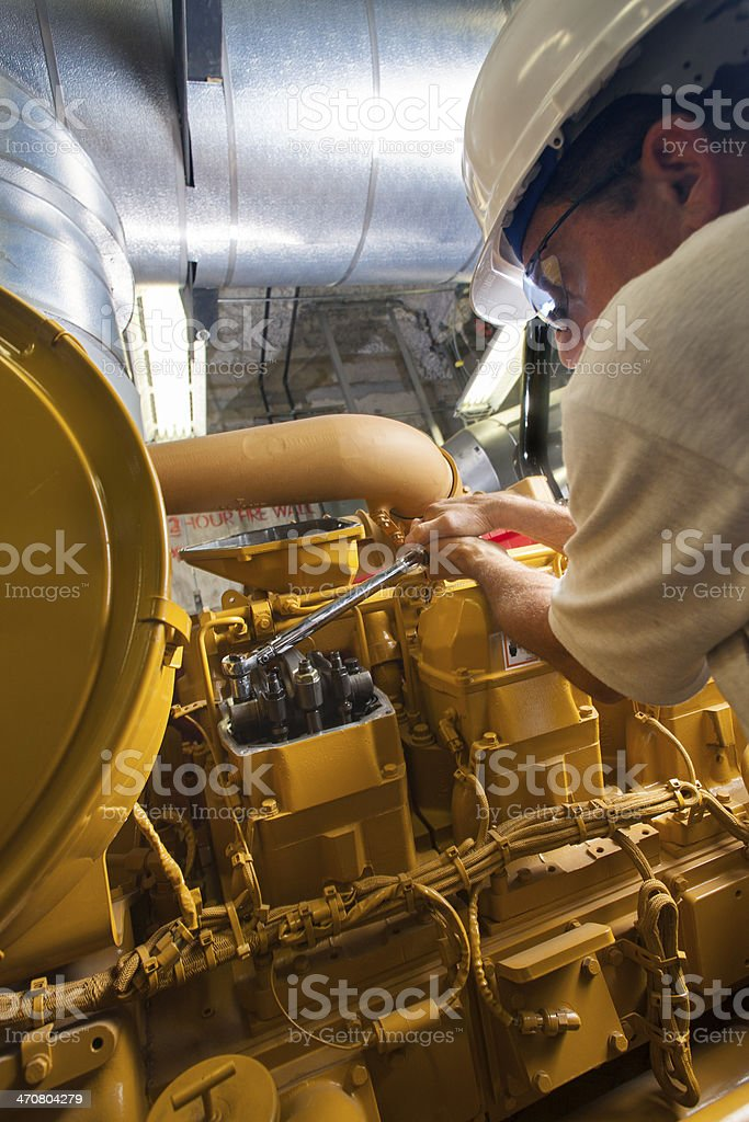 Closeup of Hands of Diesel Mechanic working stock photo
