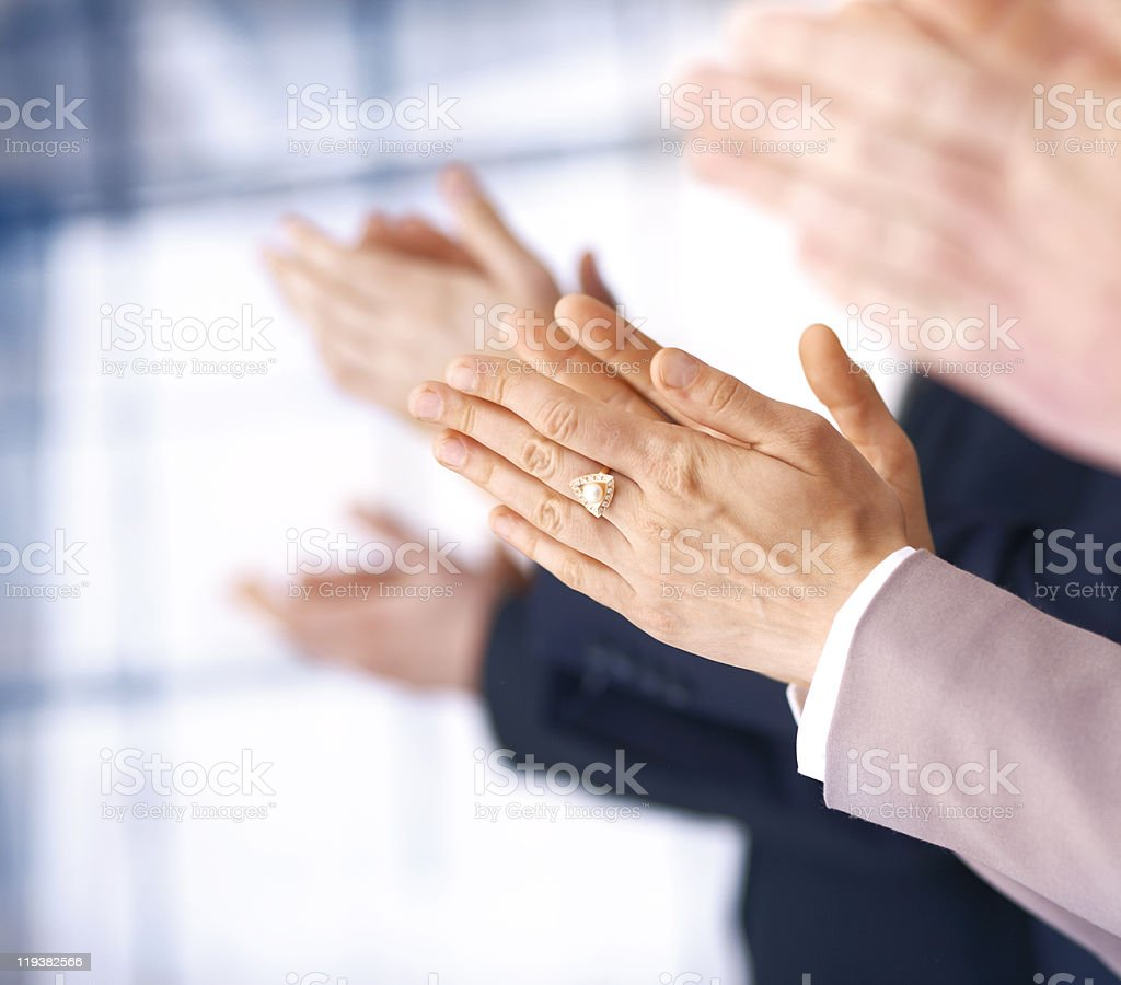 Close-up of hands of people wearing suits clapping stock photo