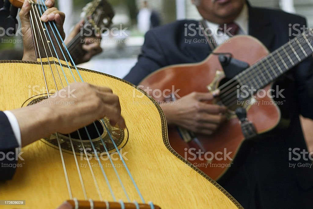 Close-up of hands playing guitar royalty-free stock photo