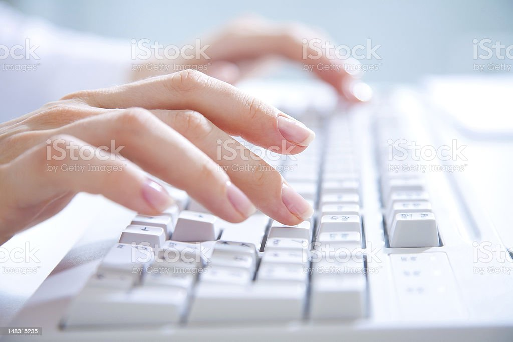 Close-up of hands typing on a computer keyboard royalty-free stock photo