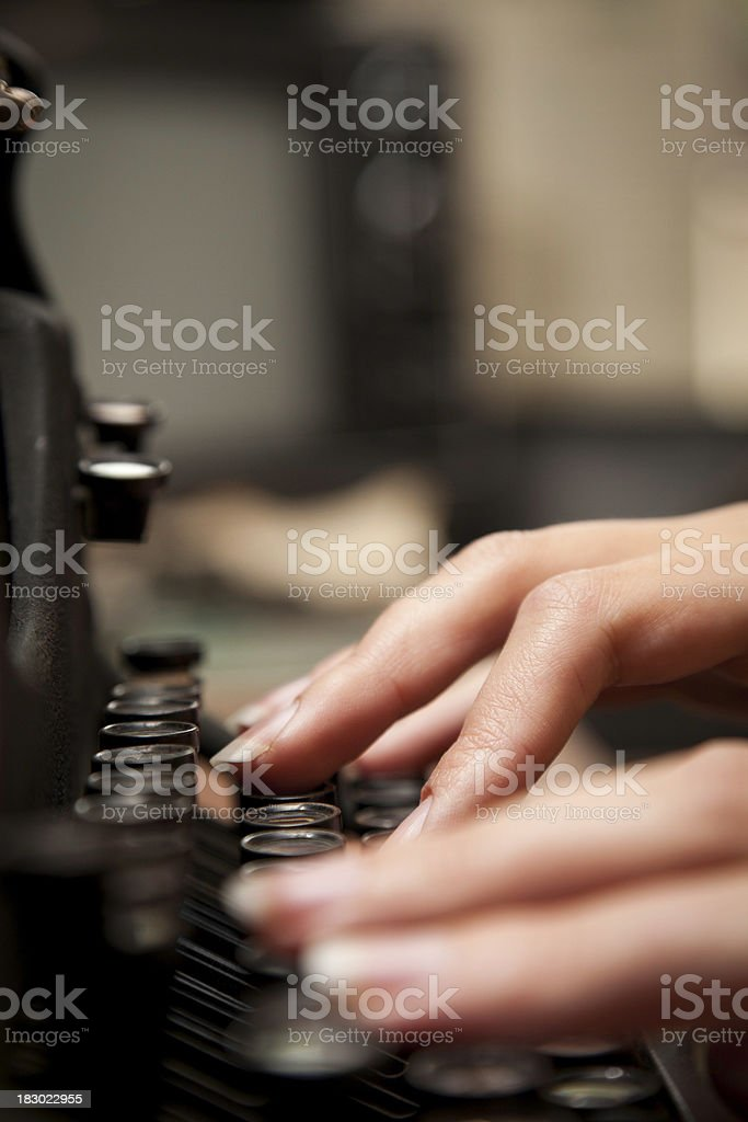 Closeup of Hands Typing on Old Fashioned Typewriter royalty-free stock photo