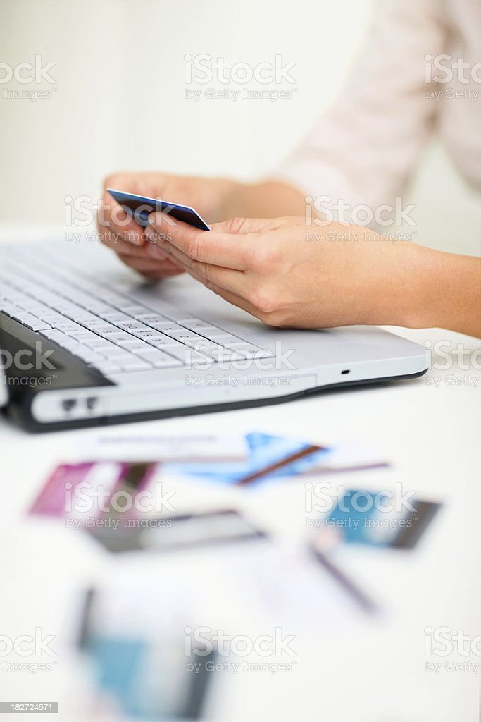 Close-up of hands with credit card doing online shopping royalty-free stock photo
