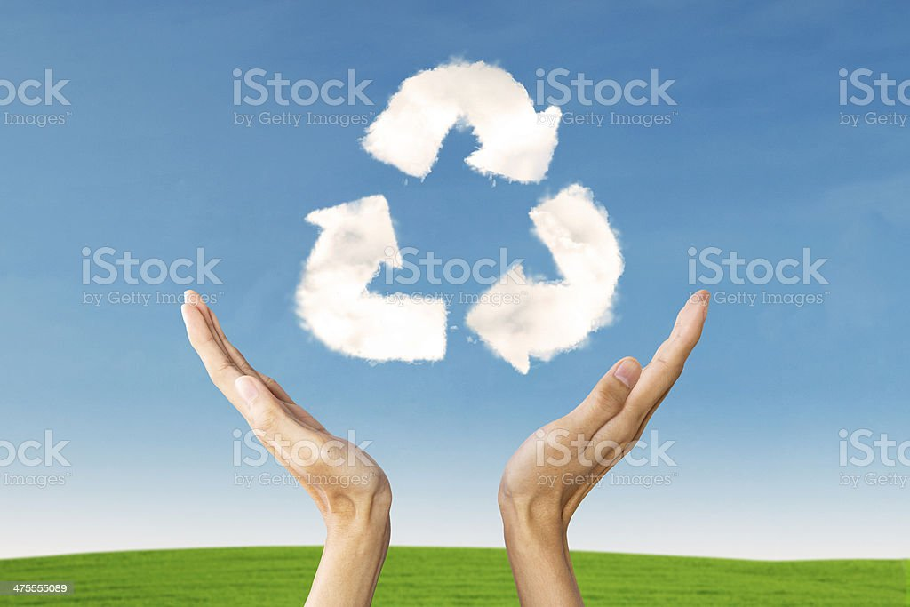 Closeup of hands with recycle sign stock photo