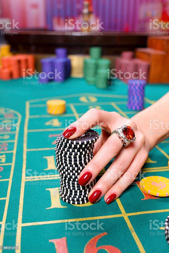 Close-up of hands woman handling a big pile gambling. stock photo