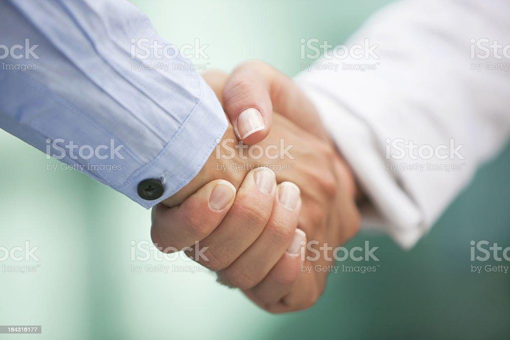 Closeup of handshake royalty-free stock photo