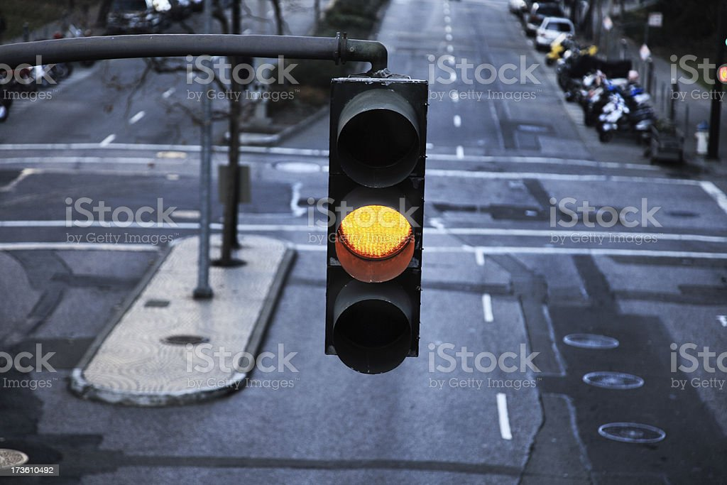 Close-up of hanging traffic light with yellow light on stock photo