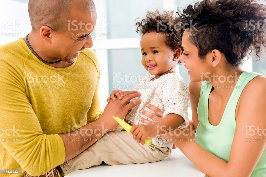 Close-up of happy African American family in the kitchen. stock photo
