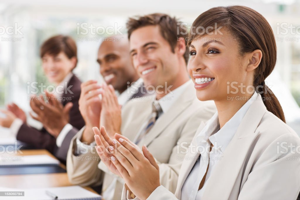 Closeup of happy businesspeople clapping royalty-free stock photo