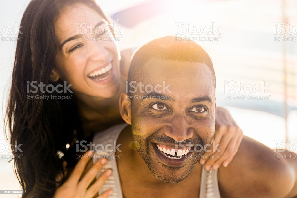 Close-up of happy couple on sunny day stock photo