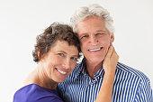 Closeup of Happy Elderly Couple Hugging