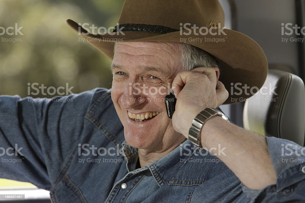 Close-up of happy farmer on mobile phone stock photo