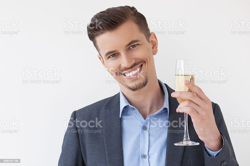 Closeup of Happy Handsome Business Man Toasting stock photo