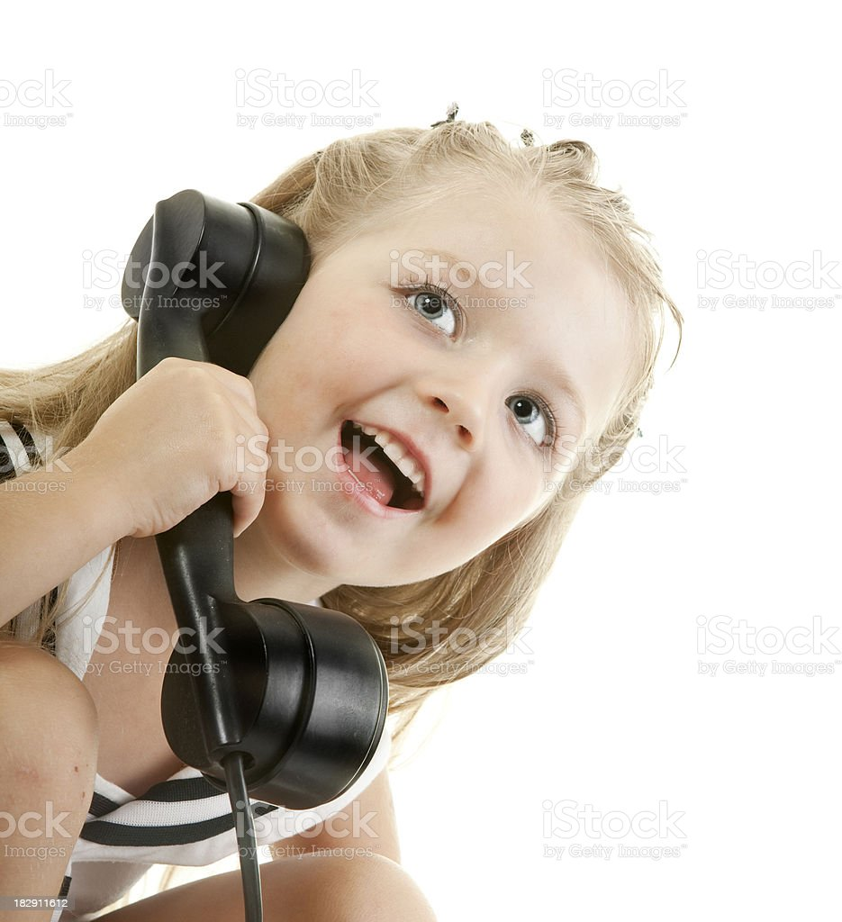 Close-up of Happy Little Girl Talking on the Phone. royalty-free stock photo