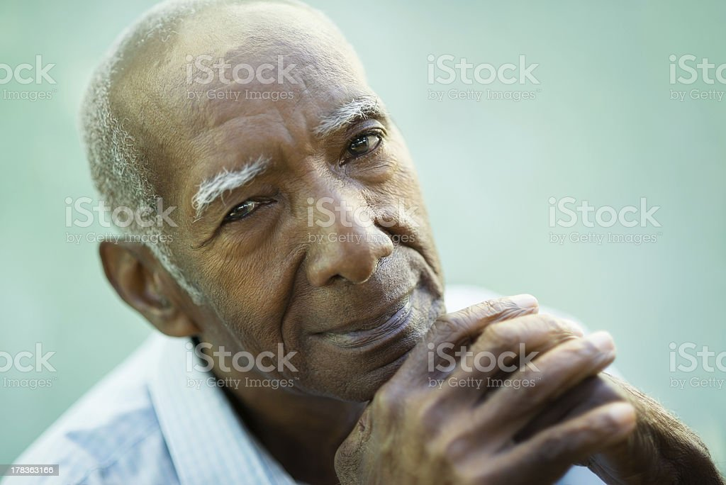 Closeup of happy old black man smiling at camera stock photo