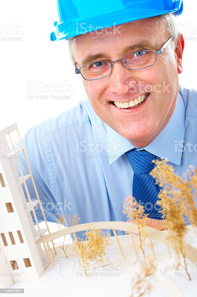Close-up of happy senior architect with model building royalty-free stock photo