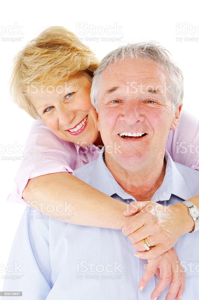 close-up of Happy Senior couple hugging on white background royalty-free stock photo