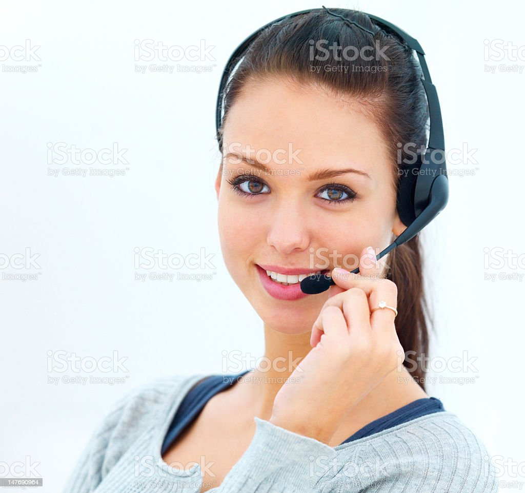 Close-up of happy young woman talking on headset royalty-free stock photo