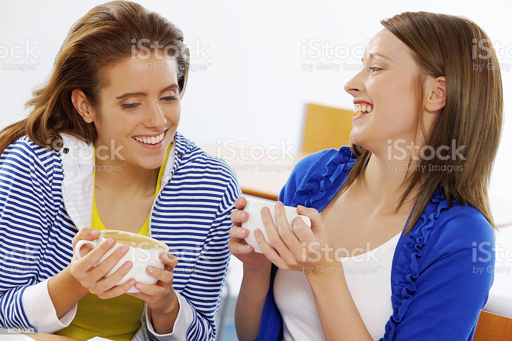 closeup of happy young Women chatting and laughing in cafe royalty-free stock photo