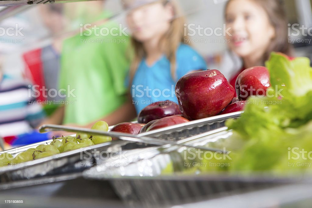 Closeup of healthy food in a school cafeteria lunch line stock photo
