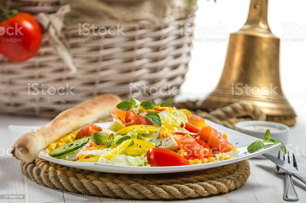Closeup of healthy salad with salmon and fresh vegetables royalty-free stock photo