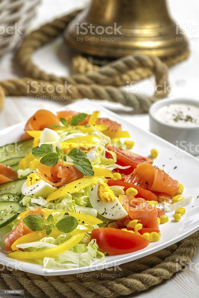 Closeup of healthy salad with salmon and vegetables royalty-free stock photo