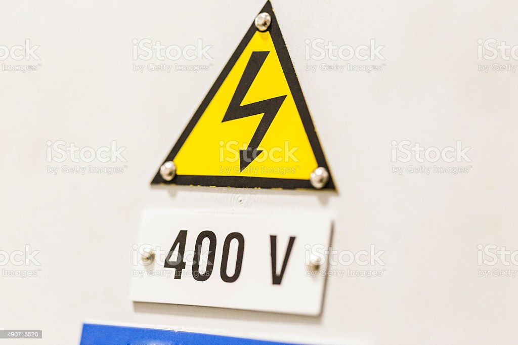 Close-up of high voltage symbol in industry stock photo