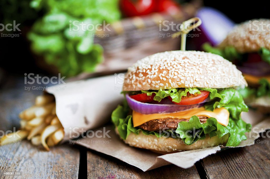Closeup of home made burgers on wooden background stock photo